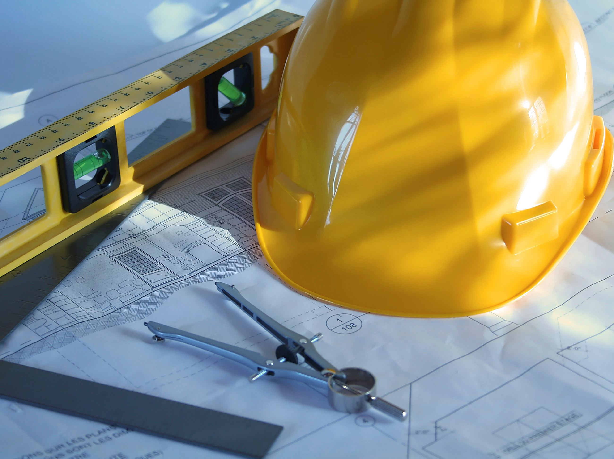 Construction hat and plans stock image